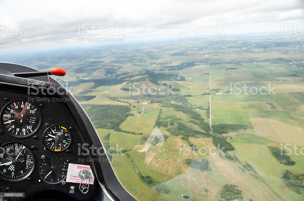 Glider Cockpit with view of far below and instrument panel stock photo
