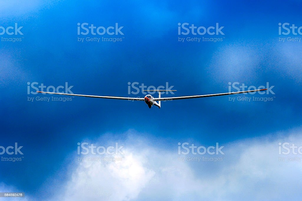 Glider flying in a turbulent stormy sky stock photo