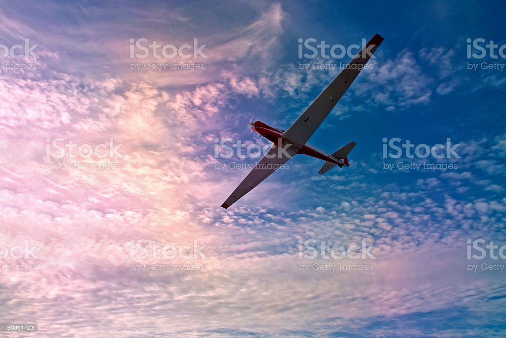 Glider gliding against a beautiful colored sky royalty-free stock photo