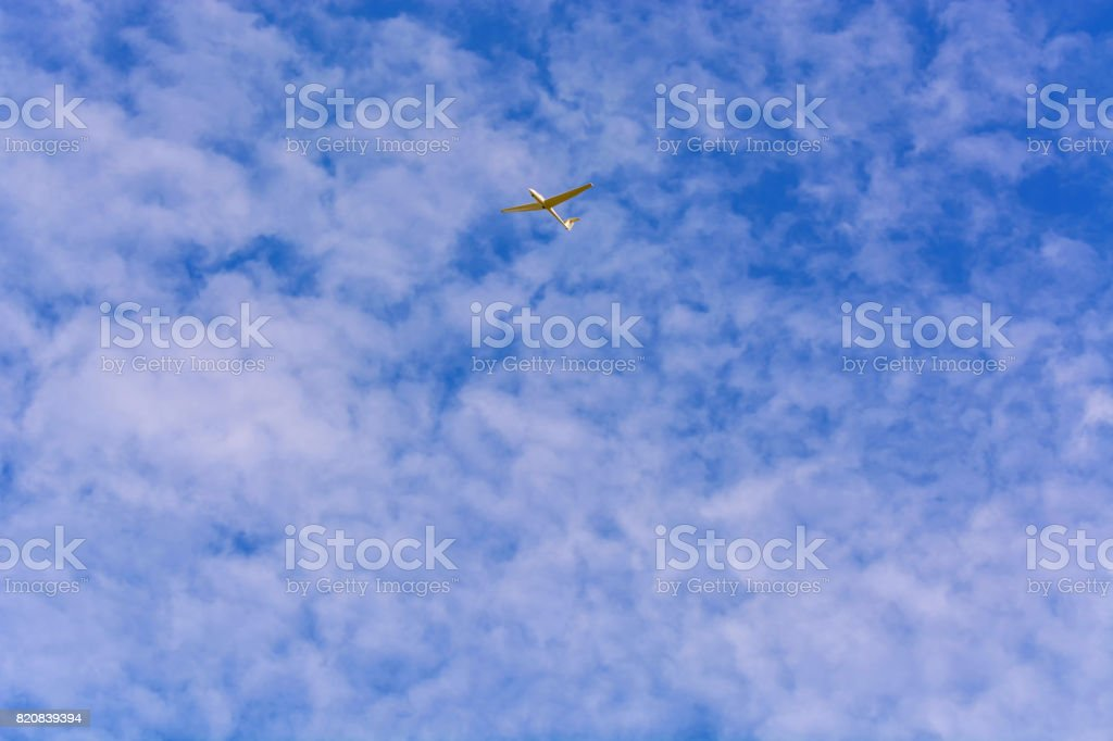 Glider in front of blue sky. stock photo