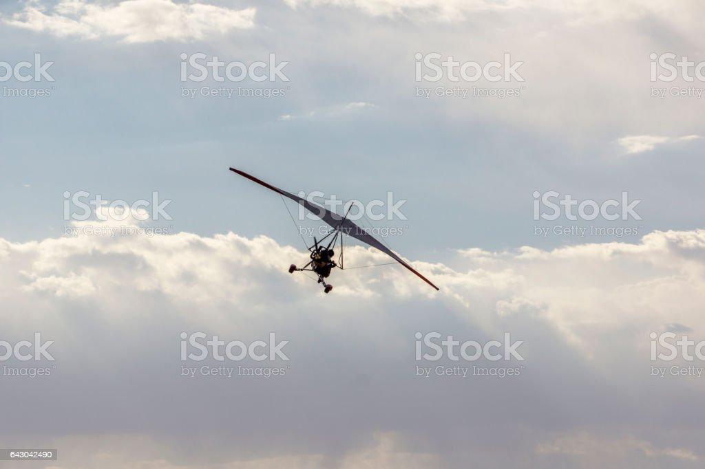 glider in sky stock photo