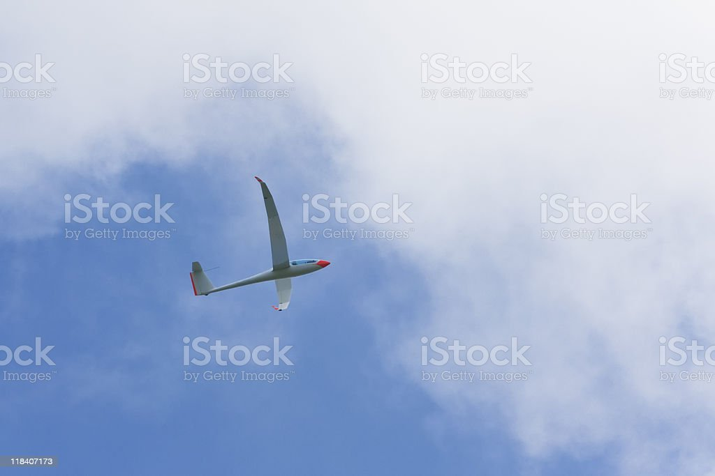 glider in the clouds stock photo