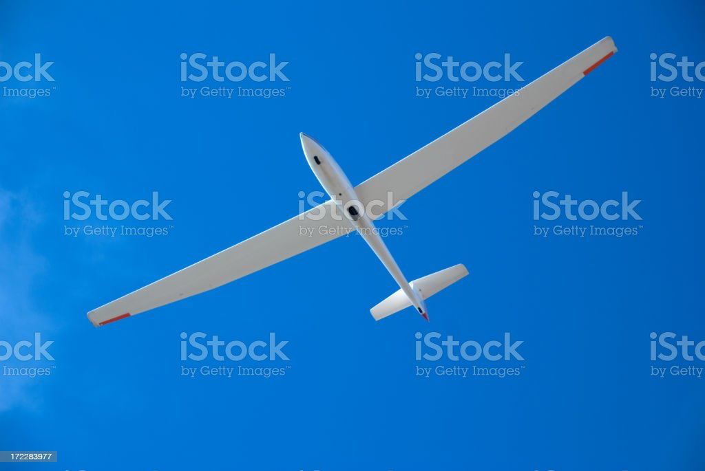 Glider or Soar Plane Against a Perfect Blue Sky stock photo