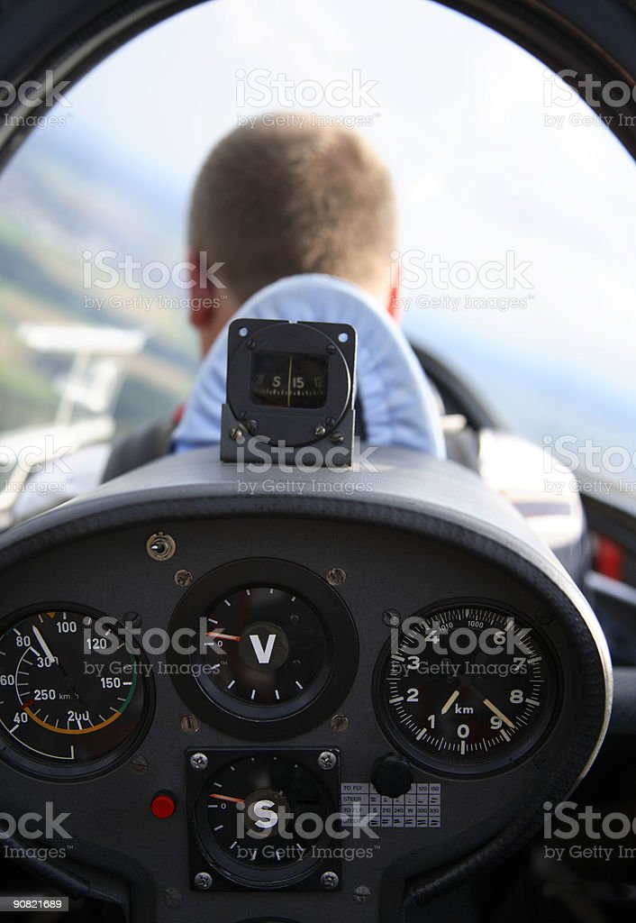 Glider pilot in cockpit during a flight stock photo