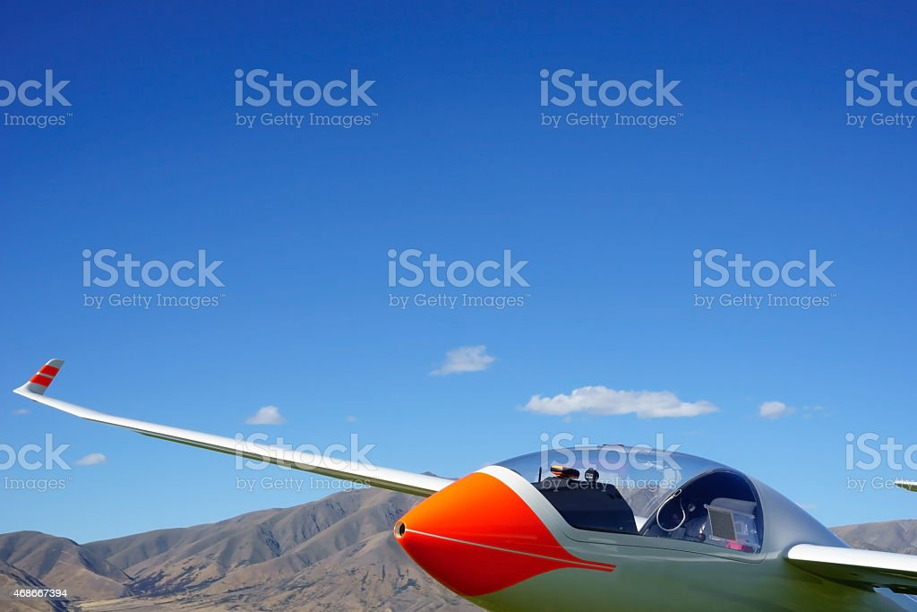 Glider under clear blue sky stock photo