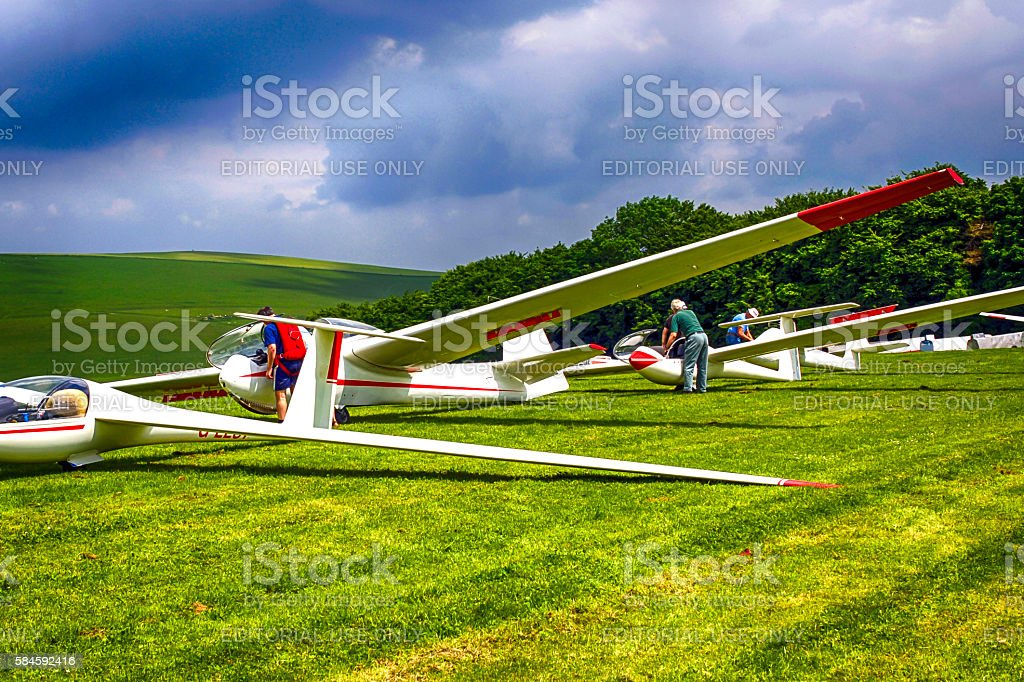 Gliders on a grass runway waiting for a tow stock photo