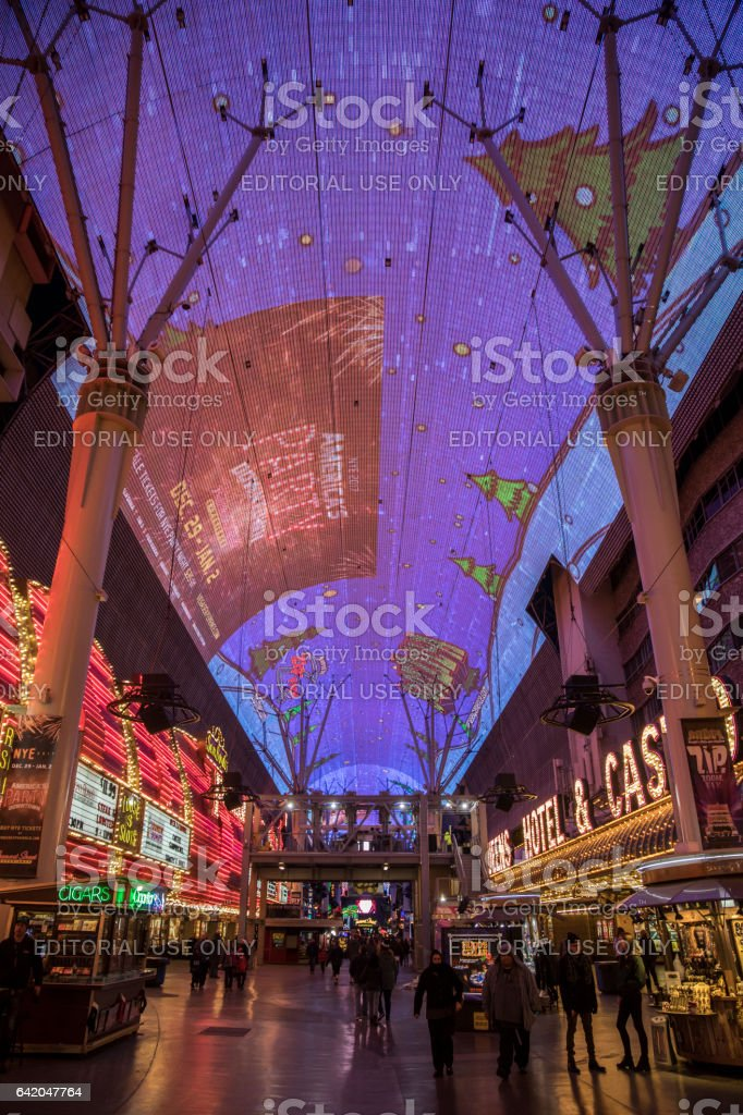 A glimpse at the facades of Fremont and Four Queens Hotels and Casinos, both situated on the famous Fremont street. stock photo