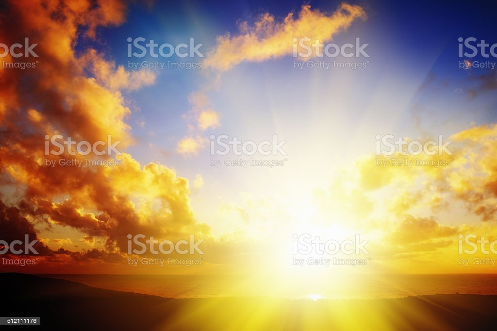 Glimpse of heaven: golden sunset over ocean horizon stock photo