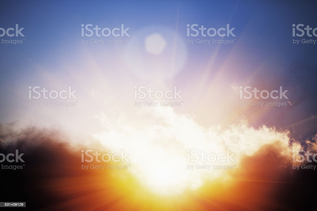 Glimpse of Heaven: sun breaking through storm clouds stock photo