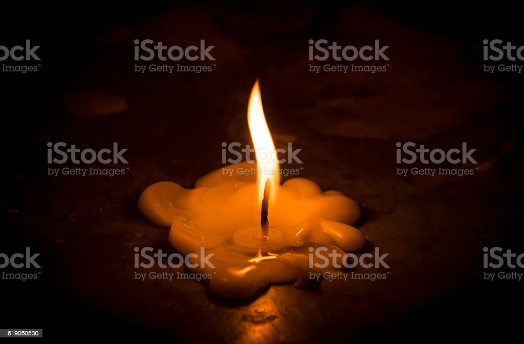 glimpses Candle and Candles are melting on floor stock photo