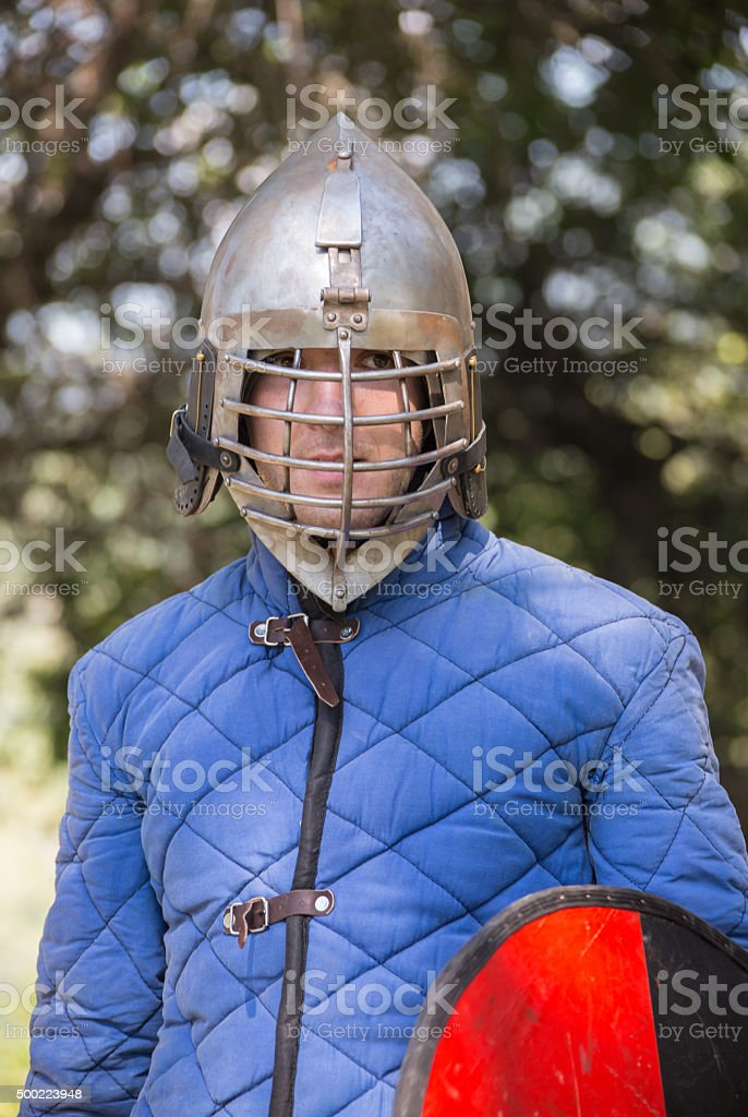 Glistening Knight holding handed sword stock photo