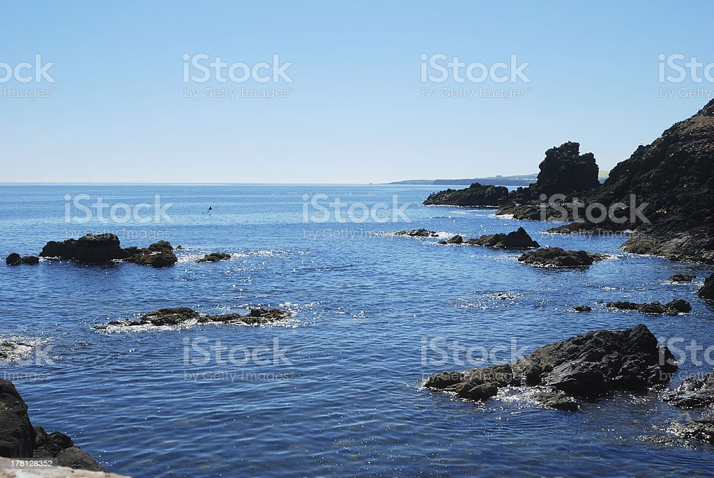 glistening sea and rocks looking south from St. Abbs royalty-free stock photo