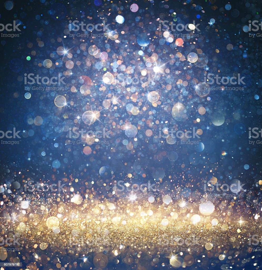 Glitter Gold And Blue With Sparkling Of Stars stock photo