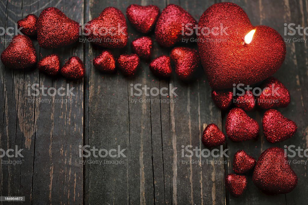 Glitter heart shapes an old wooden background royalty-free stock photo