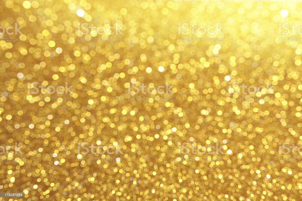 Glitter in gold coloration stock photo