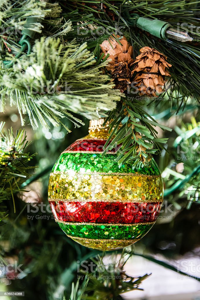 Glitter Ornament on a Christmas Tree stock photo