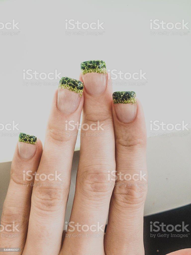 Glittered Green and black nail art stock photo