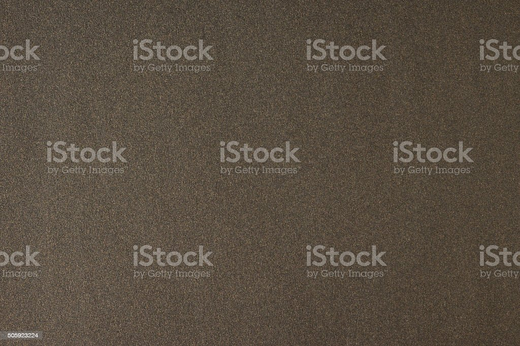 Glittering brown paper sheet texture background. Sparkling golden bronze pattern. stock photo