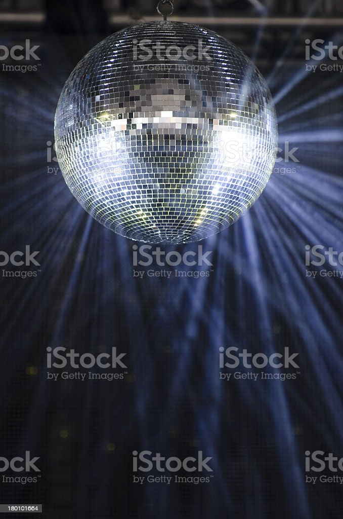 A glittering disco ball in the middle of the dance floor stock photo