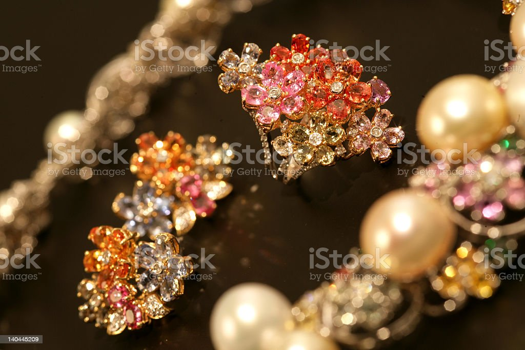 Glittering gold and diamond earrings royalty-free stock photo