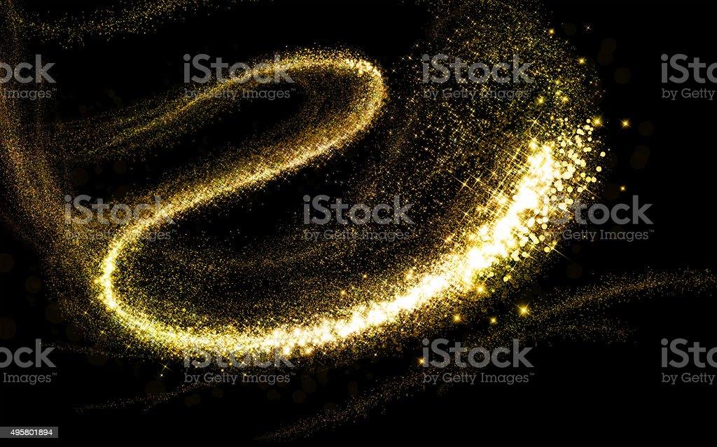 Glittering gold cosmic dust tail stock photo