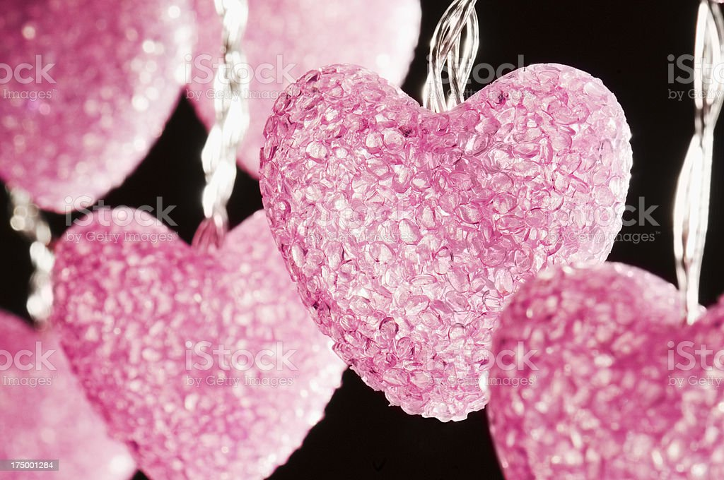 Glittering Pink Hearts lights on a black background royalty-free stock photo