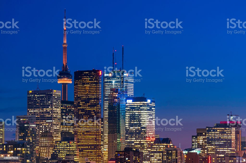 Glittering skyscrapers futuristic cityscape illuminated at dusk Toronto Ontario Canada stock photo