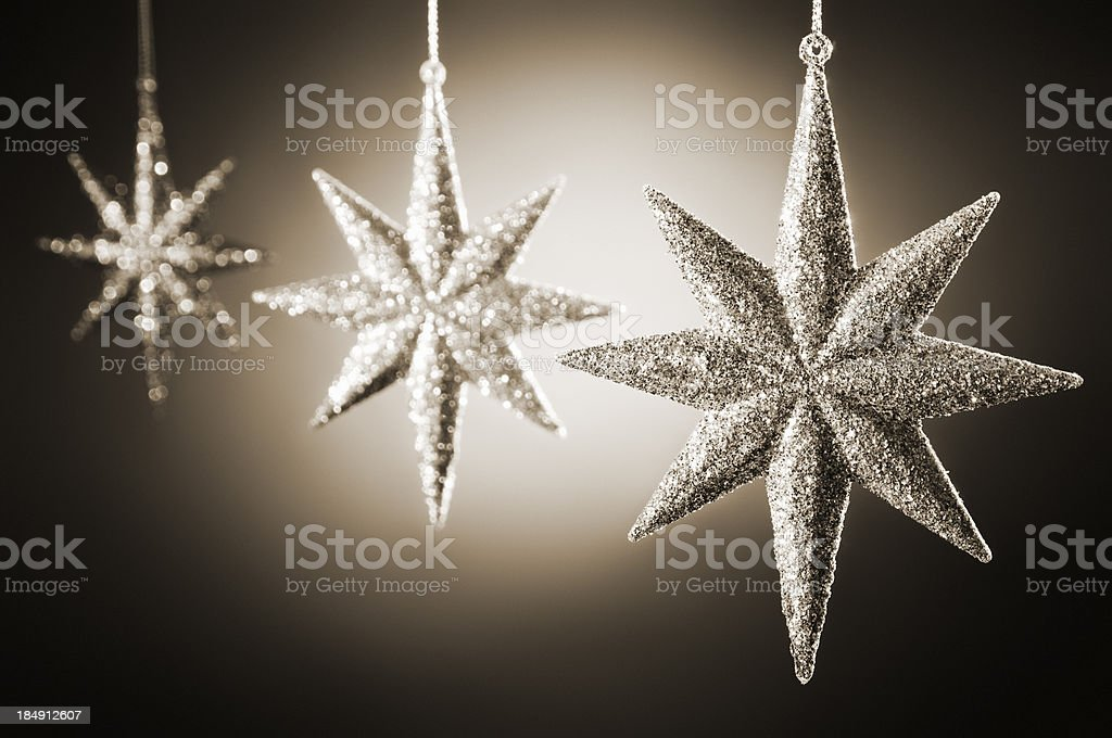 Glittering star shaped christmas decorations in silver royalty-free stock photo