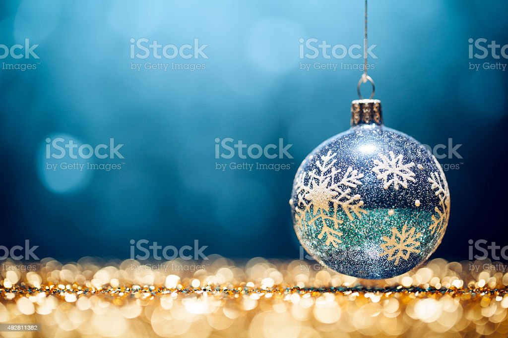 Glittery Christmas - Lights Bokeh Defocused Decoration Gold Blue stock photo