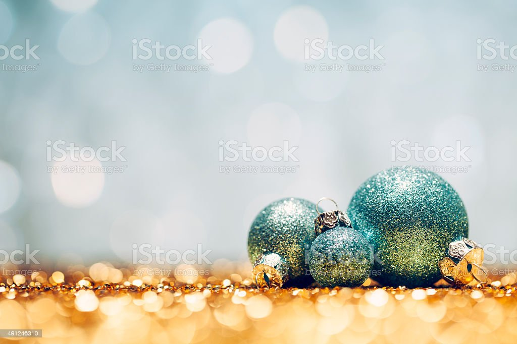 Glittery Christmas - Lights Bokeh Defocused Decoration Gold turquoise stock photo