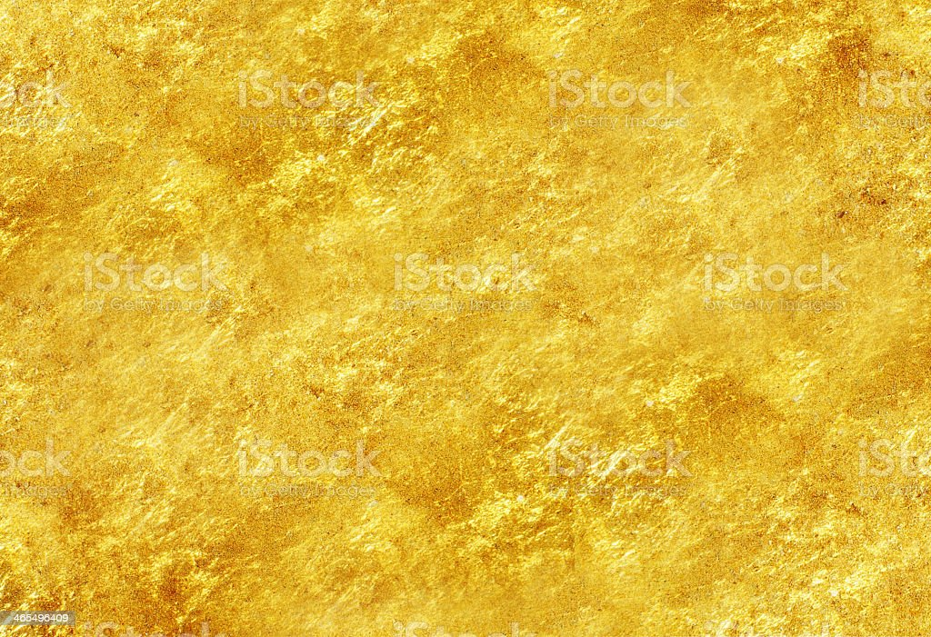 Glittery gold textured background stock photo