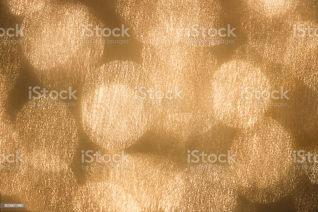 Glittery, Metallic-Gold Textured Lights Confetti Abstract Background stock photo