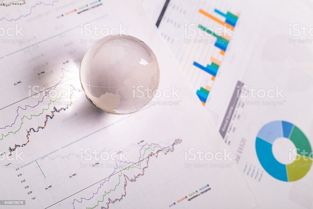 global ball on stock report document stock photo