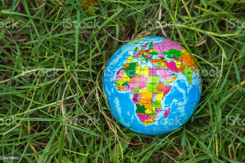 global ball toy on the grass background, environment concept stock photo