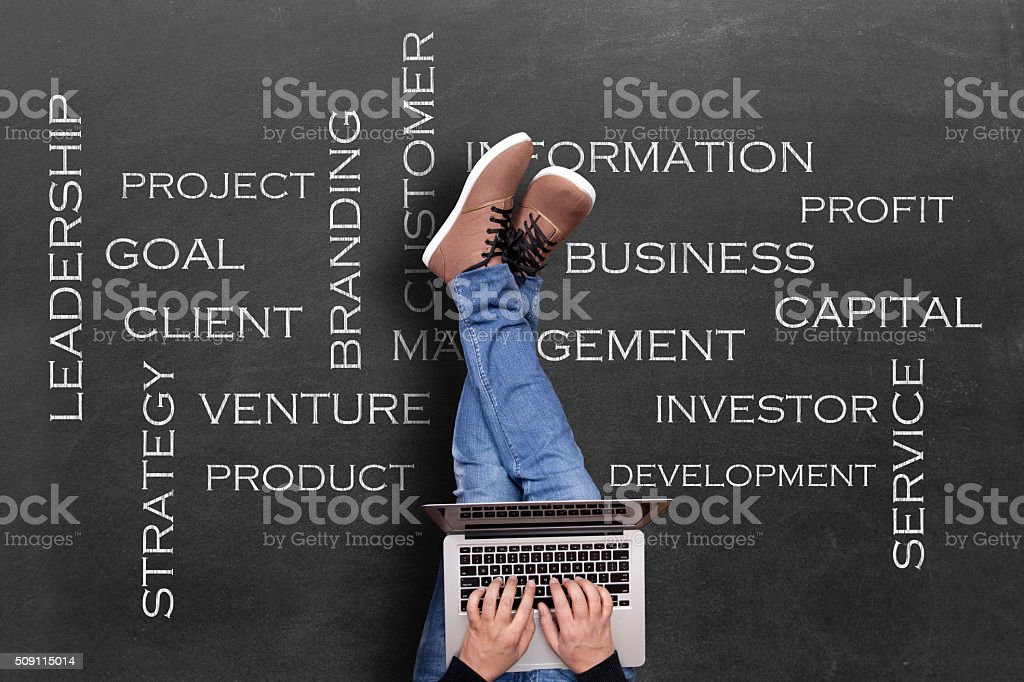 Global business analyzing with laptop stock photo