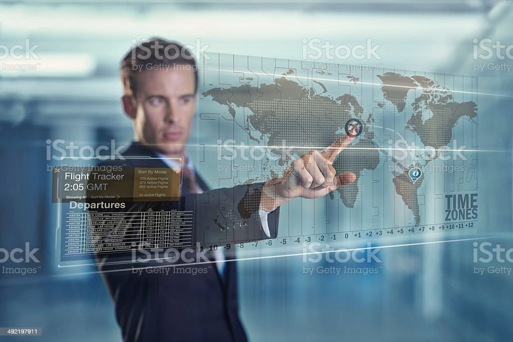 Global business at his fingertips stock photo