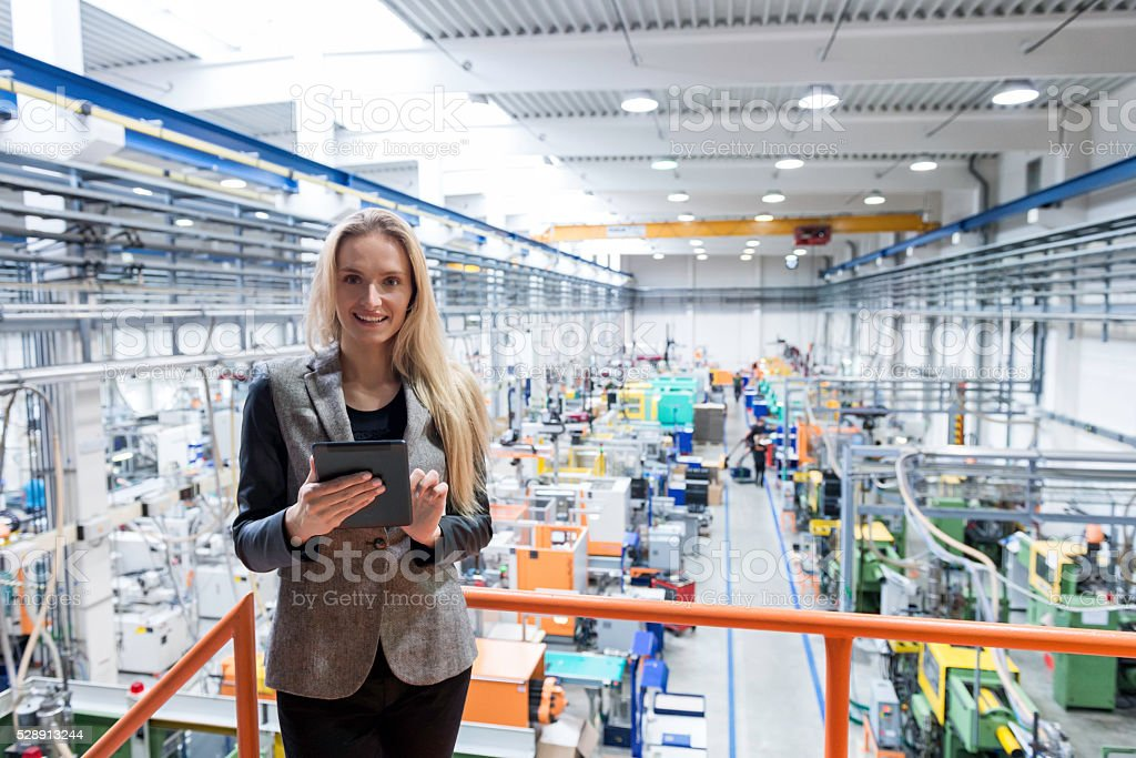Global business communication in factory stock photo