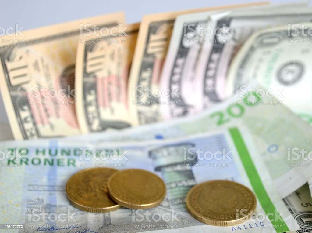 Global business. Danish and US currency. stock photo