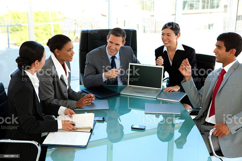 Global business meeting in board room stock photo