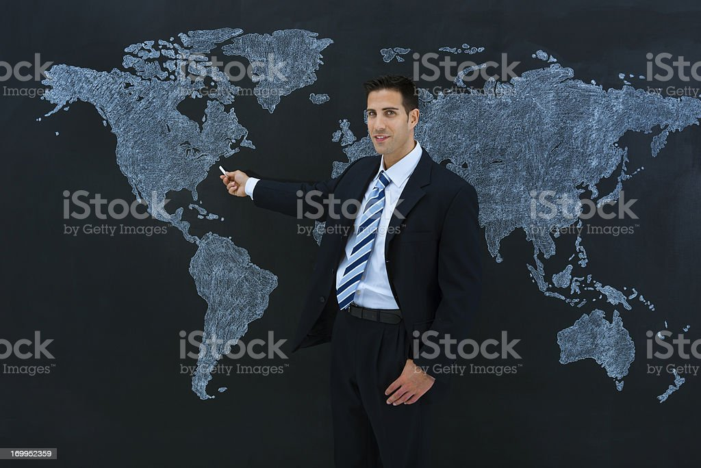 Businessman pointing to New York in a world map.