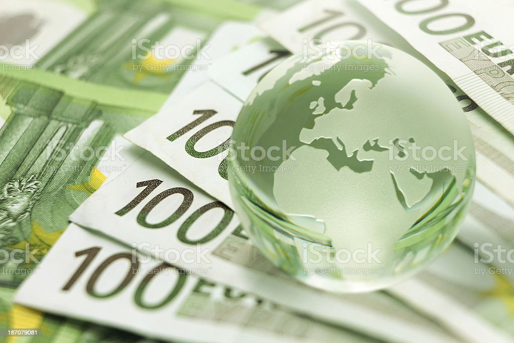 Global business with planet Earth on euro banknotes royalty-free stock photo