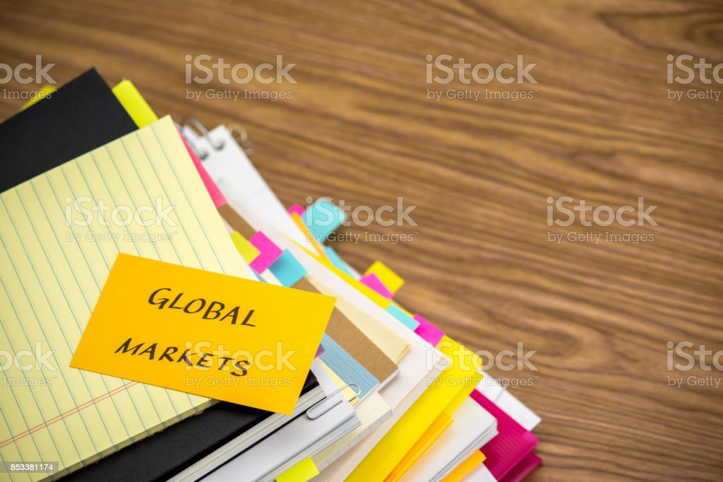 Global Markets; The Pile of Business Documents on the Desk stock photo