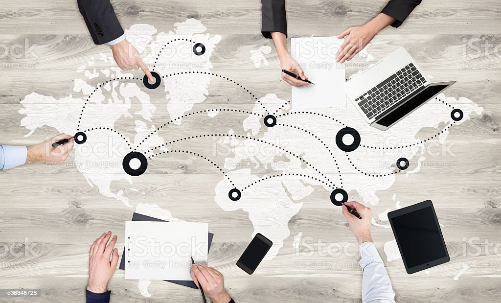 Global networking on wooden surface stock photo