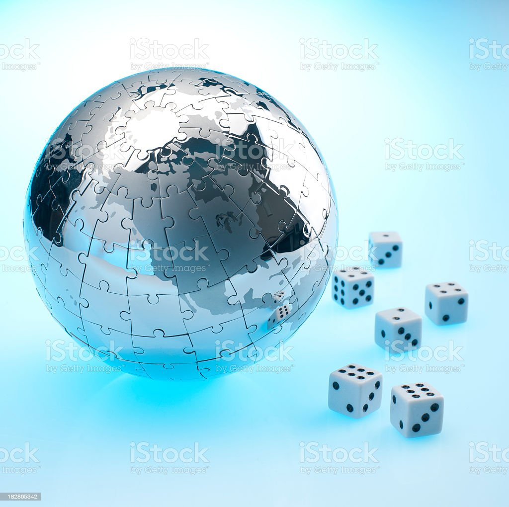 Global risk concept with dice and globe royalty-free stock photo