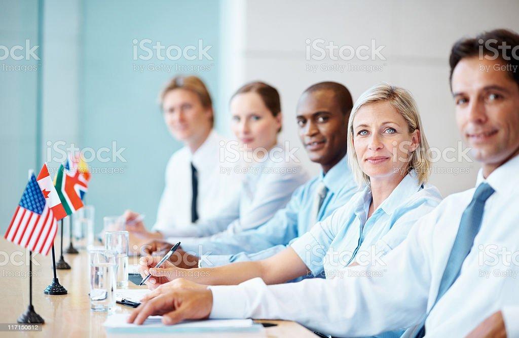 Global team attending seminar royalty-free stock photo