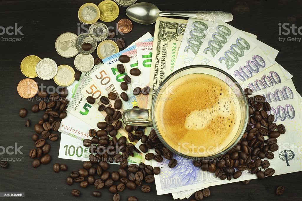Global trade coffee. Cup of coffee and money. stock photo