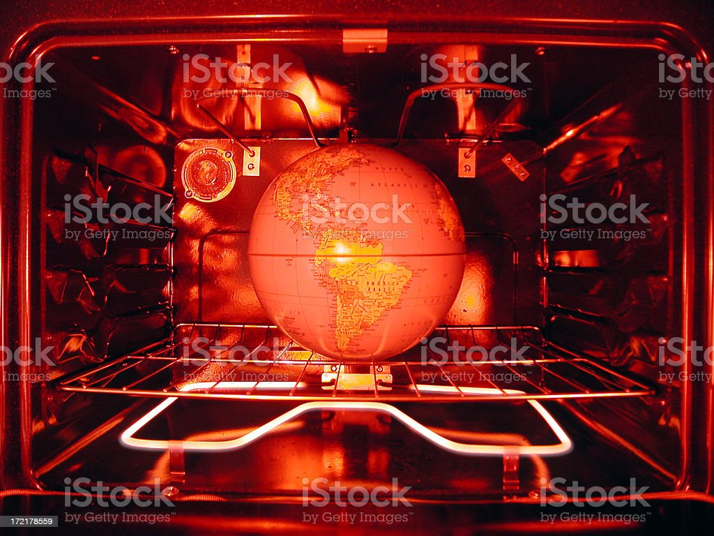 Global Warming Concept: Red-tinted Earth Globe in Oven royalty-free stock photo