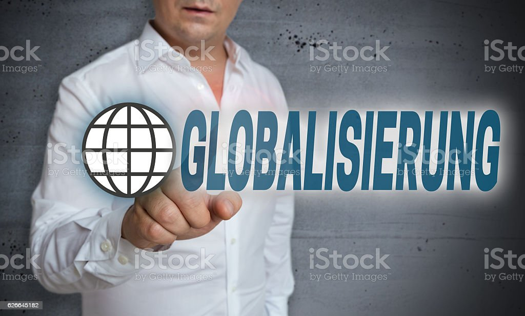 Globalisierung (in german Globalization) touchscreen is operated stock photo