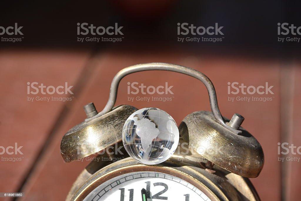 Globe and Alarm Clock stock photo