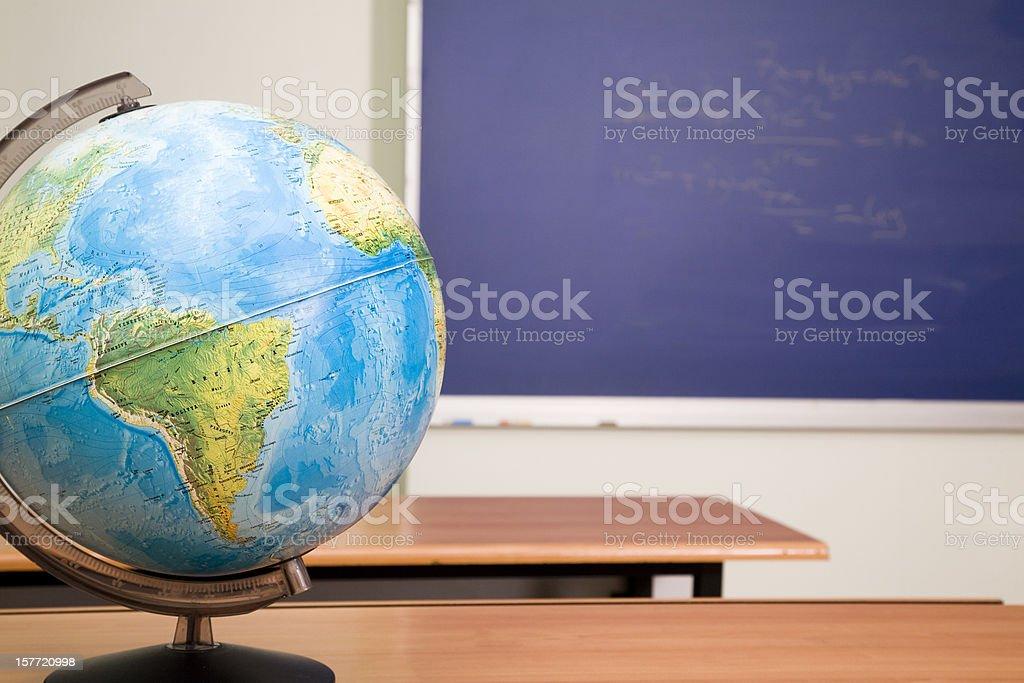 Globe and classroom royalty-free stock photo